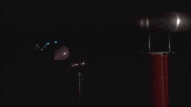 a tesla coil produces an electric current which causes an explosion. - tesla coil stock videos & royalty-free footage