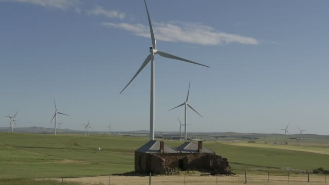 a tesla inc banner stands ahead of an event at the entrance to the hornsdale wind farm operated by neoen sas near jamestown south australia on friday... - jamestown stock-videos und b-roll-filmmaterial