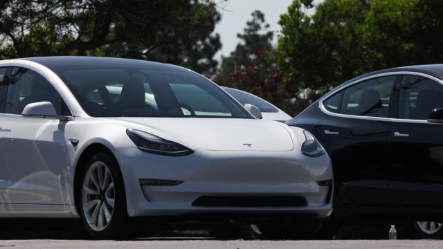 tesla inc. model 3 electric vehicles at the company's delivery center in marina del rey, california, usa, on saturday, september 29, 2018. - alternative fuel vehicle stock videos & royalty-free footage