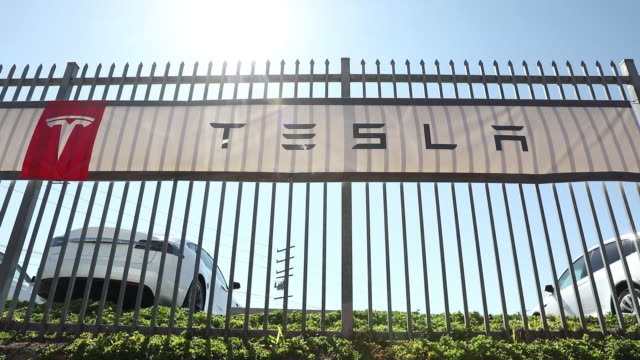 tesla inc model 3 electric vehicles at the company's delivery center in marina del rey california usa on saturday september 29 2018 - personal land vehicle stock videos & royalty-free footage