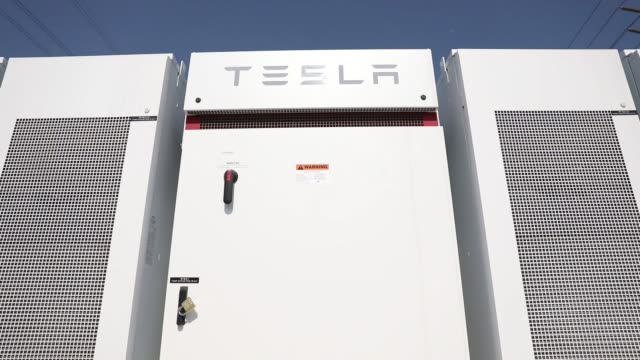 A Tesla Inc Powerpack and inverter stands at the Southern California Edison Mira Loma Battery Energy Storage System facility in Ontario California US...