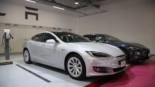 tesla motors inc model s 90d electric vehicles are parked at the company's charging station in the starfield hanam shopping complex operated by... - kyonggi do province stock videos and b-roll footage