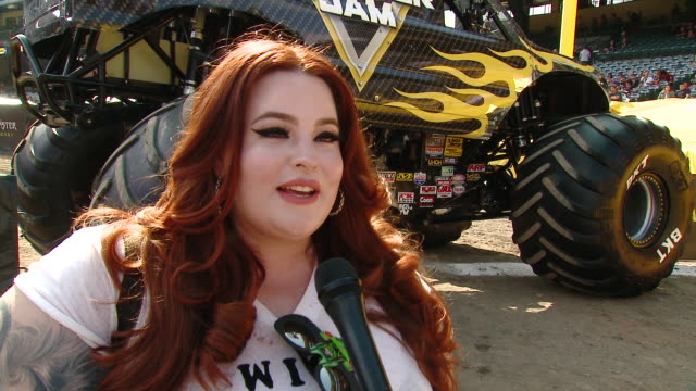 tess holliday on tell us who are you here with today and what are you looking forward to seeing at monster jam, on which truck is your favorite and... - angel stadium stock videos & royalty-free footage