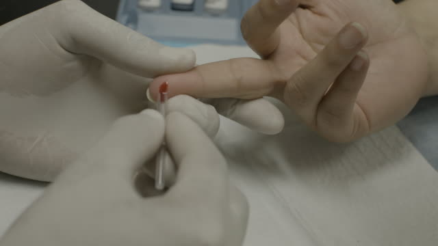 HIV test administered by doctor to patient, close-up