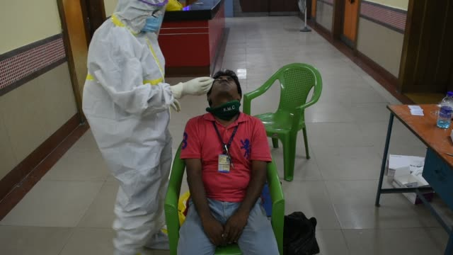 vídeos de stock e filmes b-roll de swab test along with rapid test was conducted by health workers of goverment of west bengal for the staffs of kolkata municipal corporation and other... - rapid city