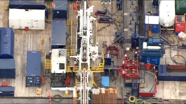 test drilling begins at west sussex fracking site; england: west sussex: balcombe: ext reporter to camera air view cuadrilla drilling site reporter... - west sussex stock videos & royalty-free footage