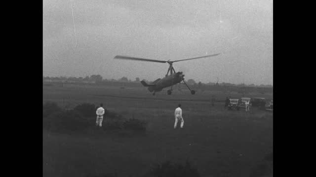 test flight for autogiro / takeoff, flight and landing / pilot climbing out of autogiro / note: exact day not known - newsreel stock videos & royalty-free footage