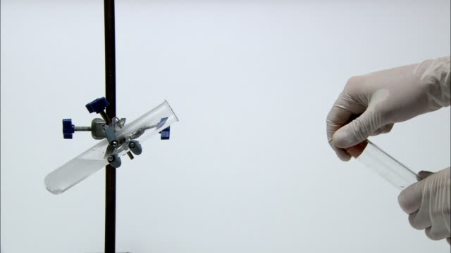 test for hydrogen gas. a lit splint is held to the gas, igniting it with a characteristic squeaky pop. the gas was produced by the reaction of magnesium with hydrochloric acid, in the test tube at left - hydrochloric acid stock videos and b-roll footage