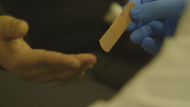 hiv test patient receives bandaid, close-up - bandage stock videos & royalty-free footage