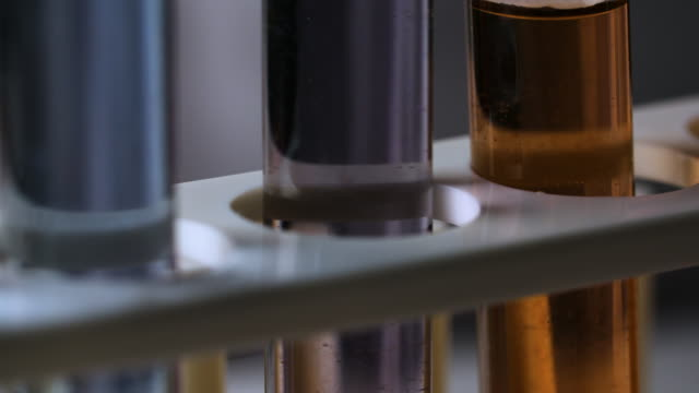 cu test tube with coloured liquid - forschung stock-videos und b-roll-filmmaterial