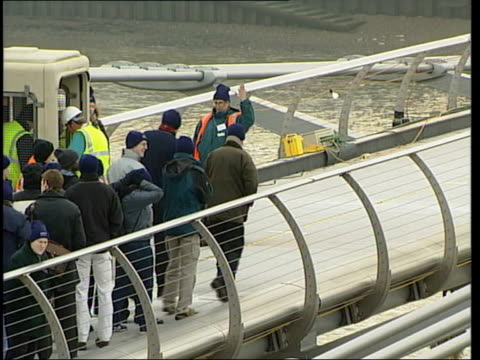 testing by construction workers millennium bridge testing by construction workers itn england london thames ms construction worker standing eating... - london millennium footbridge stock videos & royalty-free footage