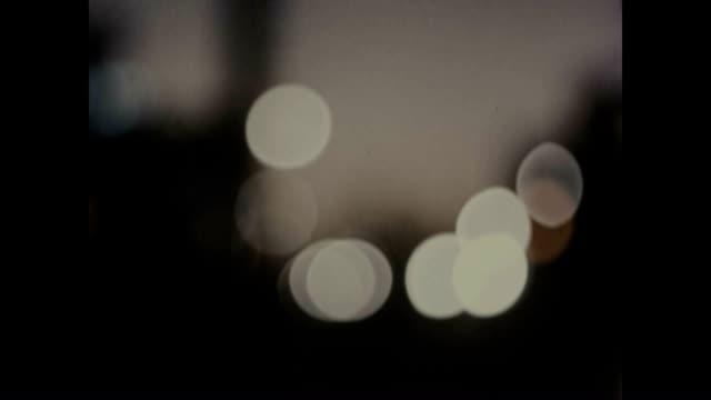 vidéos et rushes de testing lighting conditions using blurred lights. - nostalgie