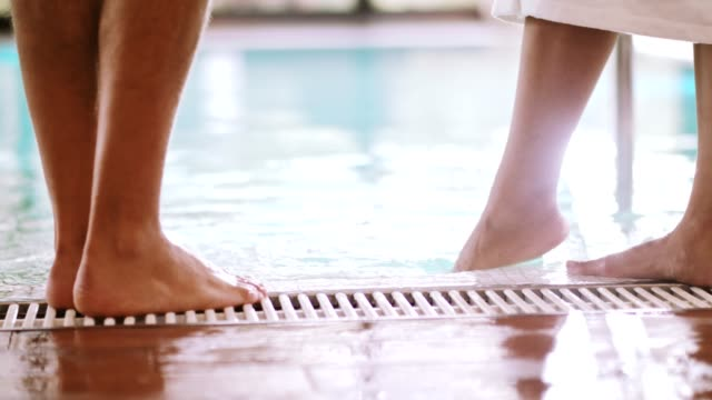 testing the water in swimming pool with foot - barefoot stock videos & royalty-free footage