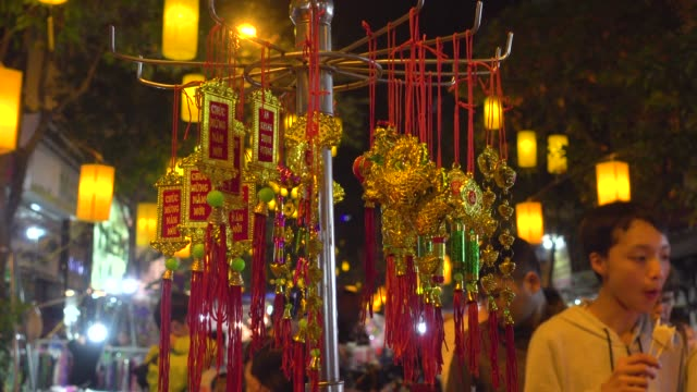 tet ornaments close-up. hanoi night market street during tet. decoration objects for new year celebration. hoan kiem old quarter district - north vietnam stock videos & royalty-free footage