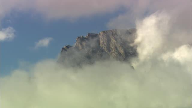 ws teton mountains peak covered with clouds / grand teton national park, wyoming, usa - grand teton national park stock videos & royalty-free footage