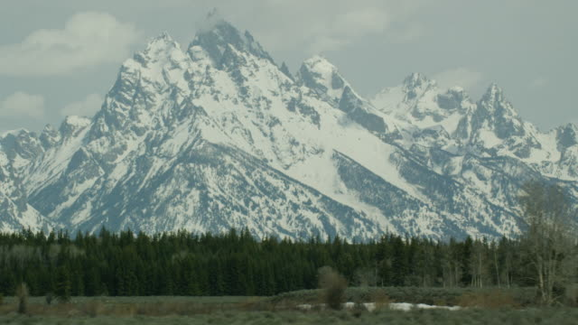 5k tetons and trees 2 - grand teton stock videos & royalty-free footage