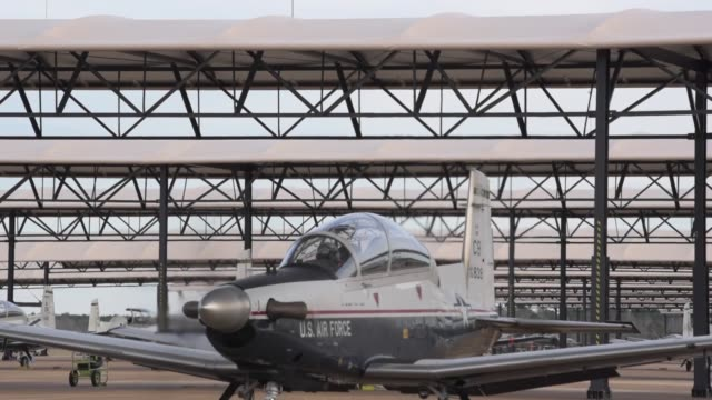 t6 texan ii's prepare and take off for training mission and takeoff from columbus air force base mississippi - us military stock videos & royalty-free footage
