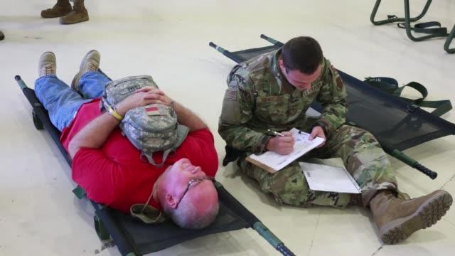 vídeos de stock e filmes b-roll de texas army national guard together with multiple government agencies conduct a hurricane readiness exercise at galveston military base, texas - planeamento civil de emergência