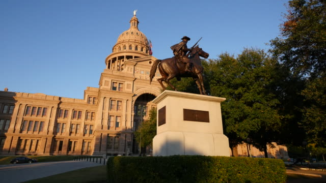 texas austin capitol and statue of texas ranger - texas state capitol building stock videos & royalty-free footage