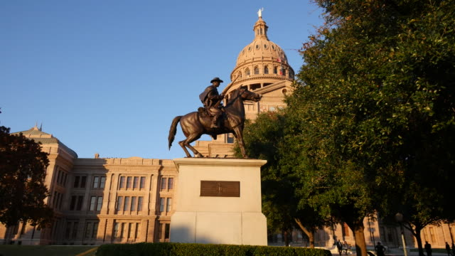 texas austin capitol and texas ranger statue - texas state capitol building stock videos & royalty-free footage