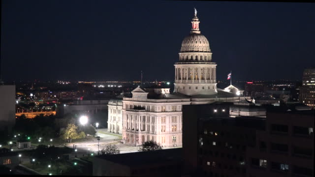 texas austin evening capitol zoom out - state capitol building stock videos & royalty-free footage