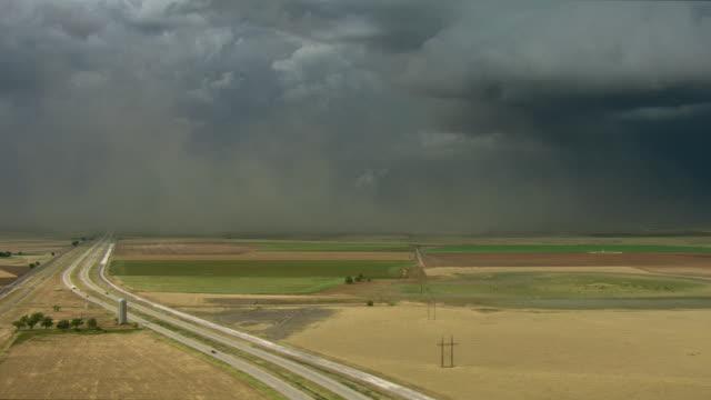 Texas Farmland Under Stormy Sky