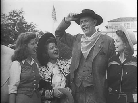 stockvideo's en b-roll-footage met texas governor coke stevenson walking with lord halifax outside the state capitol building in austin / stevensen and halifax inspecting a line of... - pilot