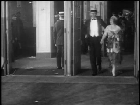 stockvideo's en b-roll-footage met texas guinan date entering theater at premiere of glorifying the american girl in nyc - 1927