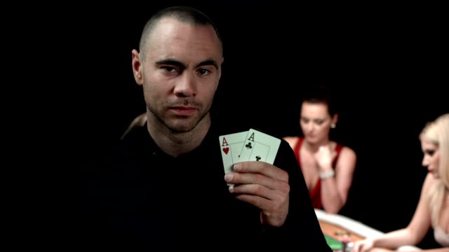 hd dolly: texas hold 'em poker player with two aces - ace stock videos and b-roll footage