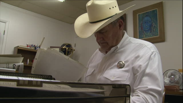 a texas ranger examines documents in an office. - cowboy hat stock videos & royalty-free footage
