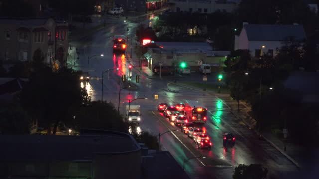 texas san antonio evening lights in traffic - wet wet wet stock videos & royalty-free footage