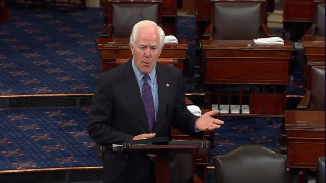 texas senator john cornyn says on the senate floor that can better equip law enforcement to stop terrorist attacks before they occur by fixing a gap... - インターセプト点の映像素材/bロール