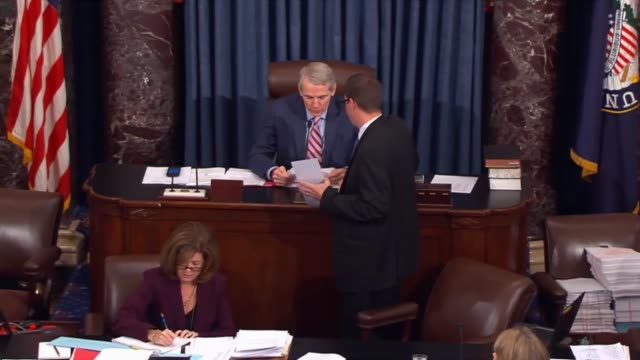 texas senator ted cruz presiding puts the question; clerk reads the motion and the title of the bill, senators vote 73-26 to consider the package of... - 米国国防総省点の映像素材/bロール