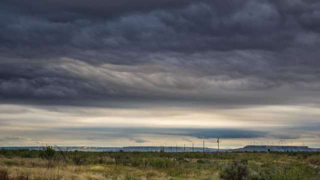 texas storm on llano estacado with distant wind farm - texas stock videos & royalty-free footage