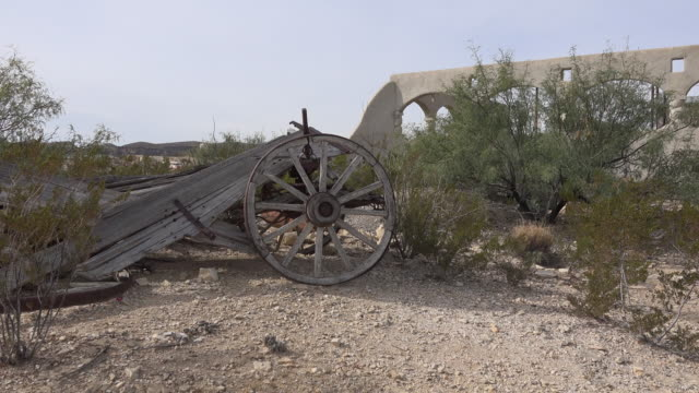texas terlingua old wagon wheel zooms in - cart stock videos & royalty-free footage