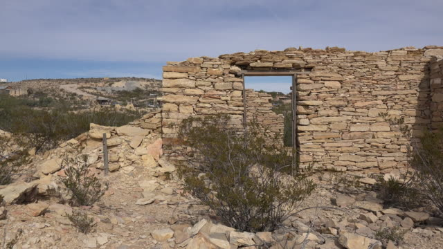 texas terlingua stone ruin with door zoom in - stone house stock videos & royalty-free footage