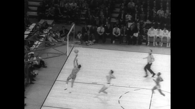 texas western basketball team playing at indoor stadium before a large crowd / player makes a basket and crowd get to feet and cheer / group of... - plakette stock-videos und b-roll-filmmaterial