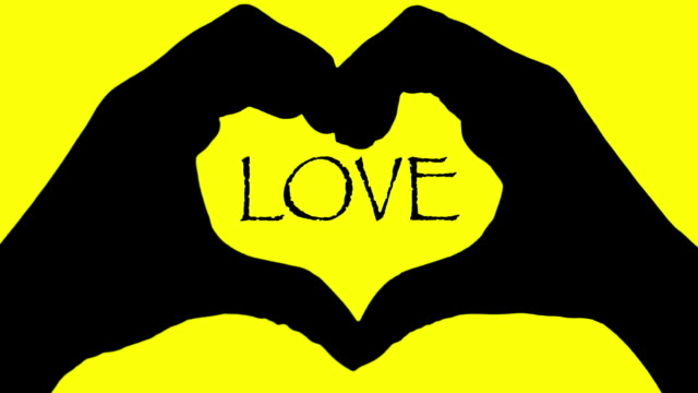 love text banner hands heart over yellow background abstrat background - i love you stock videos and b-roll footage