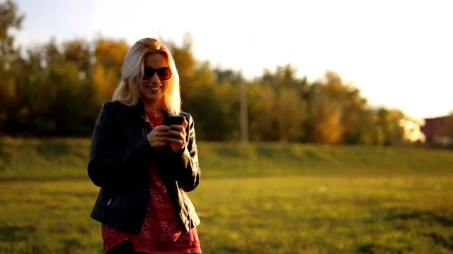 text messaging on  soft autumn sun - imperfection stock videos & royalty-free footage