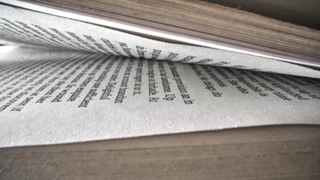 text on the pages of an open book - western script stock videos & royalty-free footage