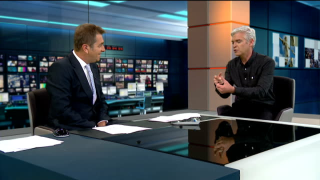 phillip schofield to present the national weather forecast; phillip schofield live interview sot - フィリップ スコフィールド点の映像素材/bロール