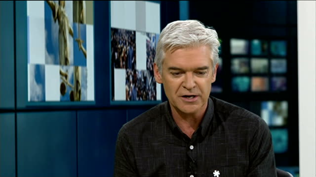 phillip schofield to present the national weather forecast; phillip schofield talking to steve scott in studio phillip schofield interview sot - フィリップ スコフィールド点の映像素材/bロール