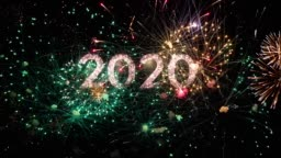2020 text with amazing fireworks in the background. Perfect for the New Year celebration greeting with colorful fireworks, typography design - Event & Festive concept 4K
