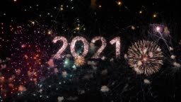 2021 text with amazing fireworks in the background. Perfect for the New Year celebration greeting with colorful fireworks, typography design - Event & Festive concept 4K