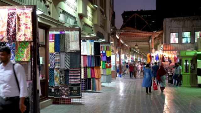 textile souk bur dubai in the old city centre - vender stock videos and b-roll footage