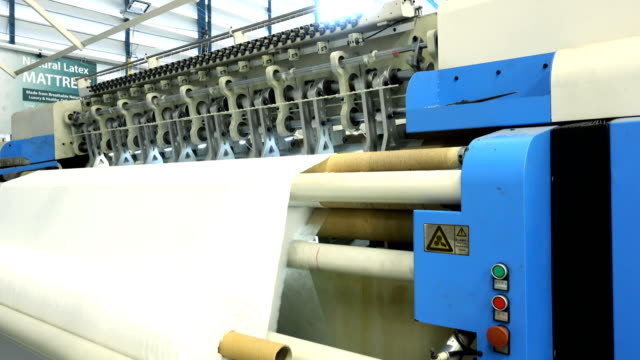 textile waeving machine in a textile factory - thread stock videos & royalty-free footage