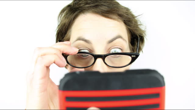 texting geek - cat's eye glasses stock videos and b-roll footage