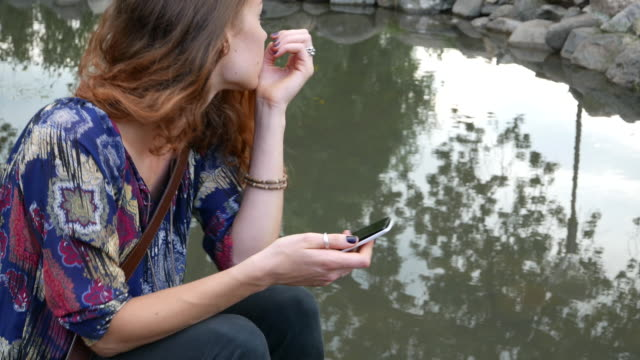 Texting outside at the pond