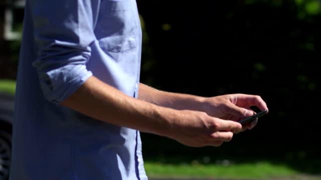 texting, suburban          li cm - pocket stock videos & royalty-free footage