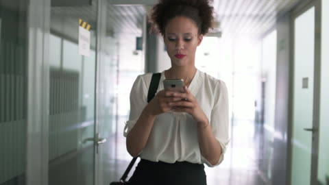 texting to her team - text stock videos & royalty-free footage